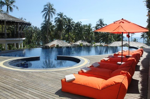 [Image: hotel-poolside-with-orange-recliners-tou...456576.jpg]